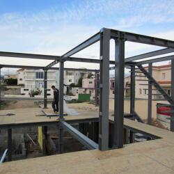 Construction On A Stell Frame House